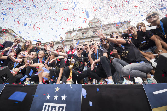 Members of the USA Women's National Soccer Team stand in front of the 2019 FIFA World Cup Trophy and get showered by confetti after the City Hall Ceremony. Each member of the team got a key to the city after winning the 2019 FIFA World Cup Championship title, their fourth, played in France against Netherlands, at the City Hall Ceremony in the Manhattan borough of New York on July 10, 2019, USA. (Photo by Ira L. Black/Corbis via Getty Images)