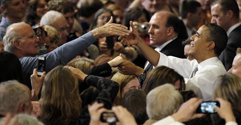 President Barack Obama shakes hands with supporters after speaking at a campaign fundraiser at the University of Vermont in Burlington, Vt., Friday, March, 30, 2012. (AP Photo/Pablo Martinez Monsivais)
