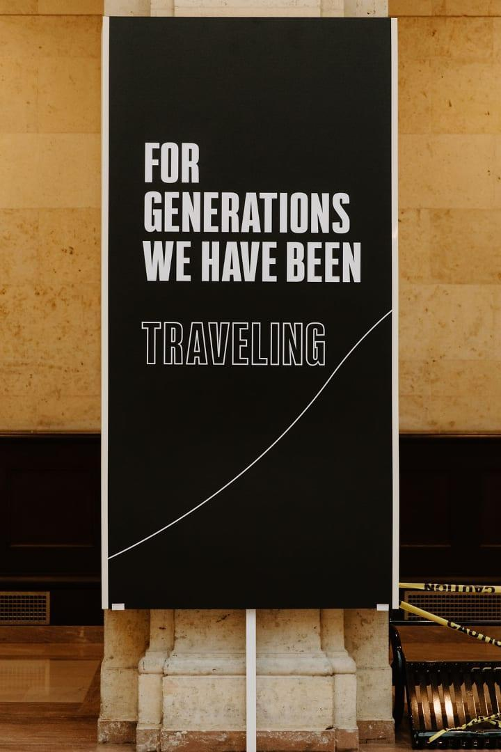 """White text on a black background that says """"FOR GENERATIONS WE HAVE BEEN TRAVELLING"""""""