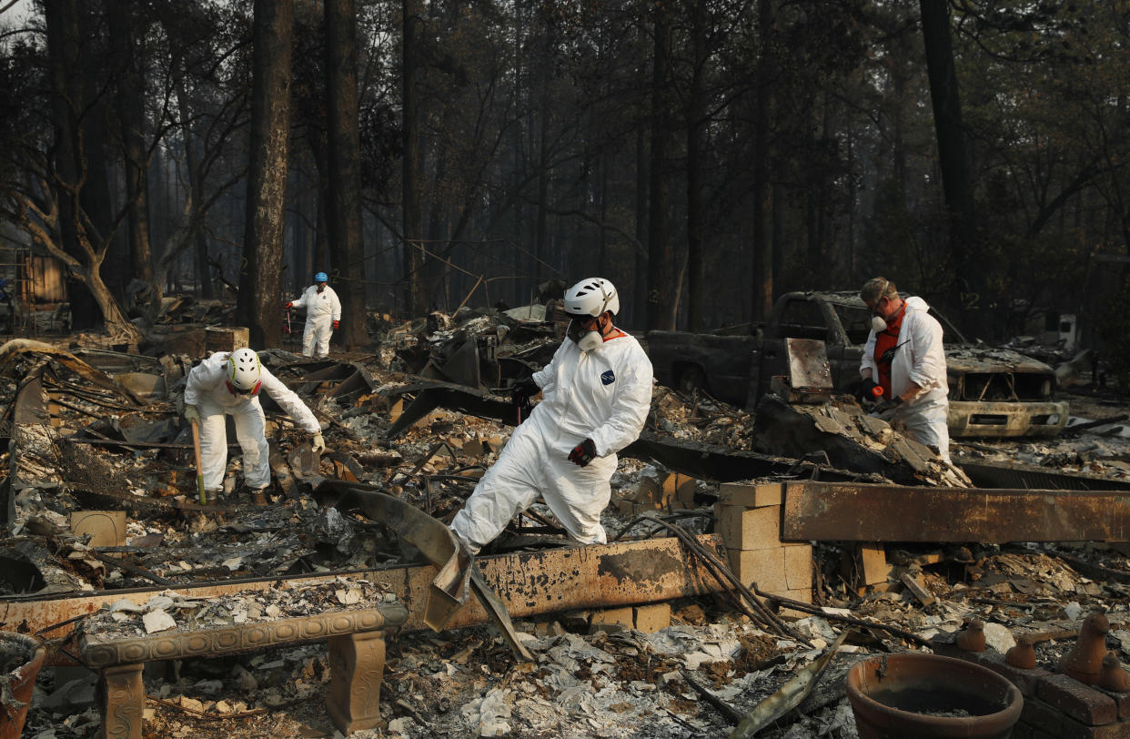 Search and rescue personnel search a destroyed home for human remains in Paradise, Calif., on Nov. 16. (Photo: John Locher/AP)