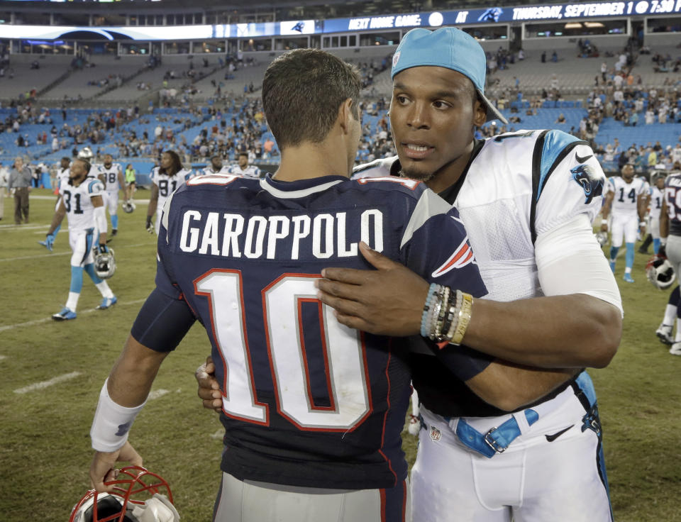 """FILE - In this Aug, 26, 2016, file photo, then-New England Patriots' Jimmy Garoppolo, left, and then-Carolina Panthers' Cam Newton, right, hug after a preseason NFL football game in Charlotte, N.C. When quarterback Jimmy Garoppolo was Tom Brady's backup in New England, his teammates used to call him """"a gamer"""" because of his ability to keep plays alive in the pocket and make throws under pressure. Now the player who was long assumed to be Brady's heir apparent returns to face his former team for the first time since being traded to the 49ers. He'll be trying to add to the recent struggles of Patriots team now led by Cam Newton that is below .500 through five games for the first time since 2001. (AP Photo/Bob Leverone, File)"""