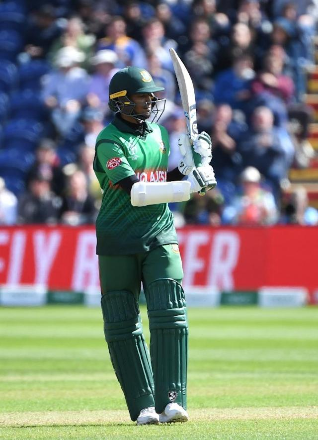 Bangladesh's Shakib Al Hasan celebrates after reaching his fifty in the World Cup match against England (AFP Photo/Paul ELLIS)