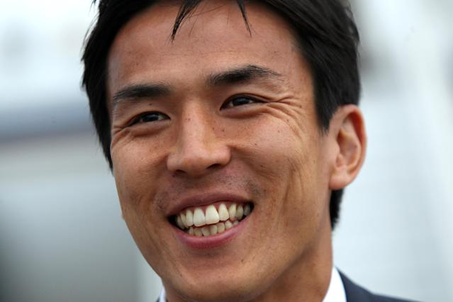 Soccer Football - 2018 FIFA World Cup - Japan Arrival - Kazan International Airport, Republic of Tatarstan, Russia - June 13, 2018. Makoto Hasebe reacts upon the arrival. REUTERS/Alexey Nasyrov