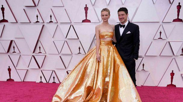 PHOTO: British actress Carey Mulligan and husband US-British musician Marcus Mumford  arrive to the 93rd Academy Awards, at Union Station, in Los Angeles, April 25, 2021. (Chris Pizzello/POOL/AFP via Getty Images)