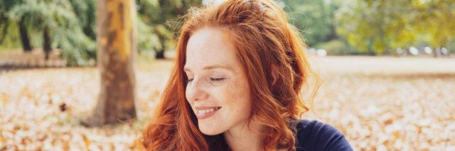 Woman relaxing in a park smiling