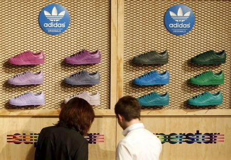 File photo of Adidas shareholders looking at shoes during the company's annual general meeting in Fuerth