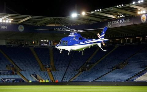 <span>The helicopter lands on the pitch after Leicester's draw with West Ham</span> <span>Credit: Reuters </span>