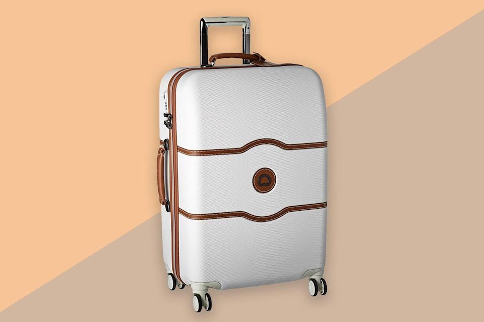 White and brown leather suitcase
