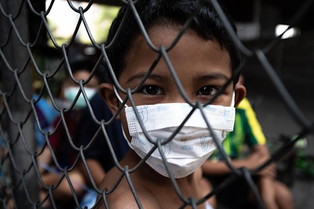 A boy wears a mask in Bangkok. (Getty Images)