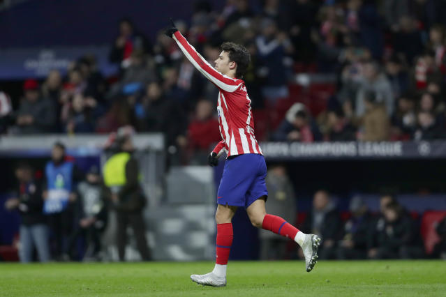 Atletico Madrid's Joao Felix celebrates after scoring the opening goal during the Champions League Group D soccer match between Atletico Madrid and Lokomotiv Moscow at Wanda Metropolitano stadium in Madrid, Spain, Wednesday, Dec. 11, 2019. (AP Photo/Manu Fernandez)