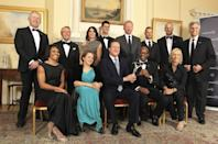 Britain's Prime Minister David Cameron (front row centre) poses for a photograph with sports personalities (back row left-right) Sean Fitzpatrick, Gary Player, Nadia Comaneci, Novak Djokovic, Boris Becker, Oscar Pistorius, Steve Regrave, Mark Spitz, (front row left-right) Kelly Holmes, Tanni Grey-Thompson, David Cameron, Edwin Moses and Martina Navratilova, during a reception for the 2012 Laureus Awards in 10 Downing Street, central London.