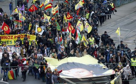 People hold placards during a demonstration organised by Kurds, in Frankfurt, Germany, March 18, 2017.  REUTERS/Ralph Orlowski