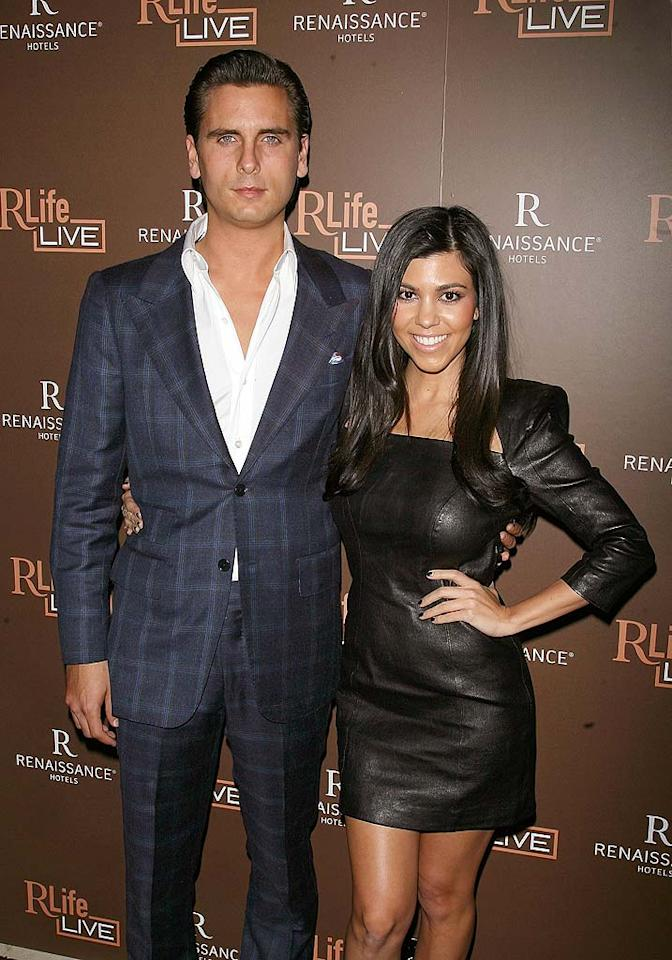 "According to <i>OK!</i>'s cover story, Kourtney Kardashian and Scott Disick are ""Engaged To Be Married!"" The magazine reveals, ""Kourtney is thrilled about it. She loves Scott, and… she's already looking at dresses."" Not only that, but <i>OK!</i> also has details about the wedding's guest list and even the reception's menu. For exclusive dish about how Disick proposed and when the couple plans to tie the knot, click over to <a href=""http://www.gossipcop.com/kourtney-kardashian-engaged-scott-disick-wedding/"" target=""new"">Gossip Cop</a>. Jim Spellman/<a href=""http://www.gettyimages.com/"" target=""new"">GettyImages.com</a> - October 28, 2010"