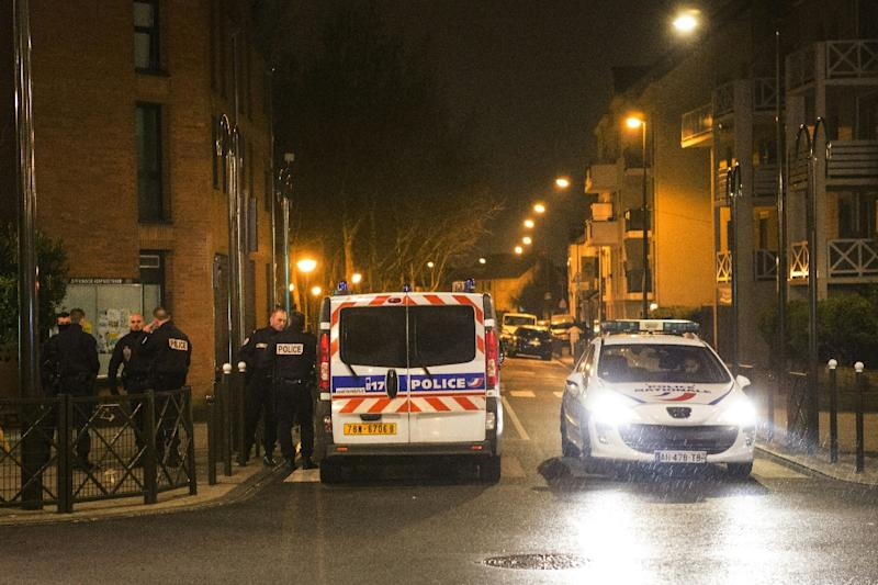A police raid on the home of Reda Kriket in Argenteuil uncovered several assault rifles and TATP explosives (AFP Photo/Geoffrety Van Der Hasselt )