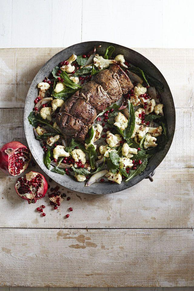"""<p>This juicy beef tenderloin is brightened by a tangy cauliflower-pomegranate salad that is sure to satisfy.</p><p><strong><a href=""""https://www.countryliving.com/food-drinks/recipes/a6207/beef-tenderloin-roasted-cauliflower-pomegranate-salad-recipe-clx1214/"""" rel=""""nofollow noopener"""" target=""""_blank"""" data-ylk=""""slk:Get the recipe"""" class=""""link rapid-noclick-resp"""">Get the recipe</a>.</strong></p>"""