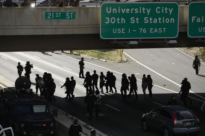FILE—In this file photo from June 1, 2020, protesters march down Interstate 676 in Philadelphia, during a march calling for justice over the death of George Floyd. Floyd died after being restrained by Minneapolis police officers on May 25. Philadelphia's mayor and police chief are scheduled to give an update Thursday, June 25, 2020, on the investigation into the police use of tear gas and rubber bullets on demonstrators who had made it onto Interstate 676 in the early June protest. (AP Photo/Matt Rourke, File)