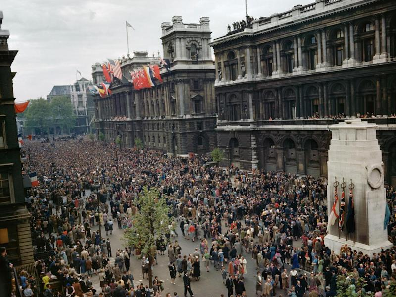 Crowds celebrating VE Day near the Cenotaph in Whitehall, 8 May 1945 (Imperial War Museum )