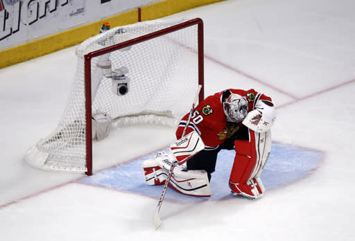 Chicago Blackhawks goalie Corey Crawford (50) looks down after giving up a goal by Los Angeles Kings defenseman Alec Martinez (27) to lose the game in the overtime period in Game 7 of the Western Conference finals in the NHL hockey Stanley Cup playoffs Sunday, June 1, 2014, in Chicago. The Kings won 5-4 in the overtime. (AP Photo/Charles Rex Arbogast)