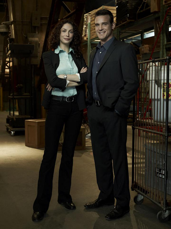 "Joanne Kelly as Myka Bering and Eddie McClintock as Pete Lattimer in ""Warehouse 13."""