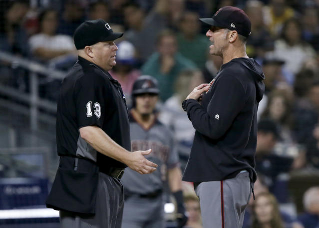 Arizona Diamondbacks manager Torey Lovullo, right, argues with home plate umpire Todd Tichenor during the seventh inning of the team's baseball game against the San Diego Padres in San Diego, Friday, Sept. 20, 2019. (AP Photo/Alex Gallardo)