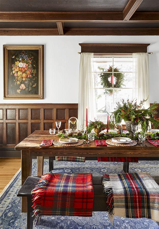 """<p>Make guests feel cozy with this easy setup—no holiday china required! Just layer on the plaid napkins and blankets as seat cushions for a little holiday pizazz. Add red or green tapers and snip greens from outside to bring this look together.</p><p><a class=""""link rapid-noclick-resp"""" href=""""https://www.amazon.com/s?k=red+plaid+blankets&tag=syn-yahoo-20&ascsubtag=%5Bartid%7C10050.g.644%5Bsrc%7Cyahoo-us"""" rel=""""nofollow noopener"""" target=""""_blank"""" data-ylk=""""slk:SHOP PLAID BLANKETS"""">SHOP PLAID BLANKETS</a></p>"""
