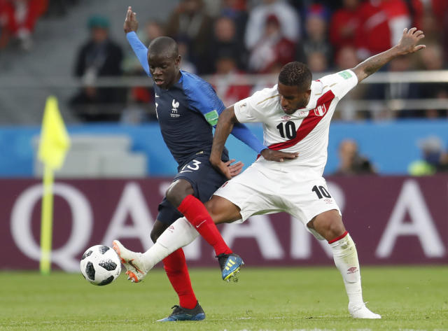 France's Ngolo Kante, left, fights for the ball with Peru's Jefferson Farfan during the group C match between France and Peru at the 2018 soccer World Cup in the Yekaterinburg Arena in Yekaterinburg, Russia, Thursday, June 21, 2018. (AP Photo/Natacha Pisarenko)