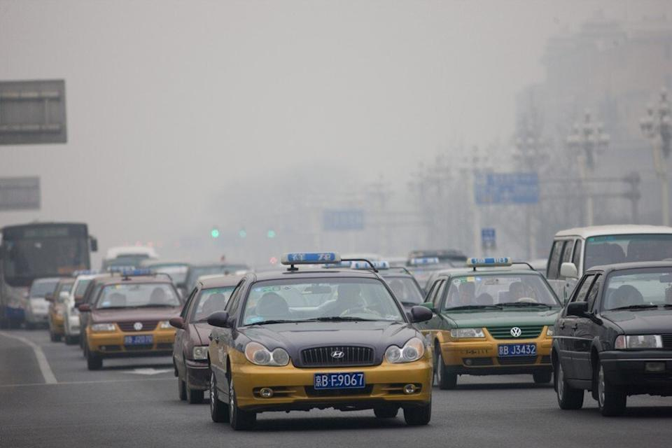 Beijing has placed strict limits on the number of licence plates it issues as a way to curb air pollution and clear the skies. Photo: Getty Images