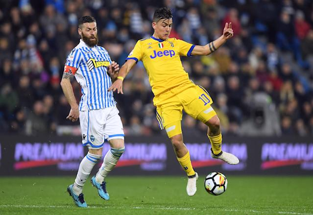 Soccer Football - Serie A - SPAL vs Juventus - Paolo Mazza, Ferrara, Italy - March 17, 2018 Juventus' Paulo Dybala in action with Spal's Mirco Antenucci REUTERS/Alberto Lingria
