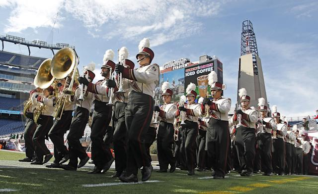 The Massachusetts marching band marches onto the field prior to an NCAA college football game against Western Michigan at Gillette Stadium in Foxborough, Mass., Saturday, Oct. 26, 2013. (AP Photo/Stew Milne