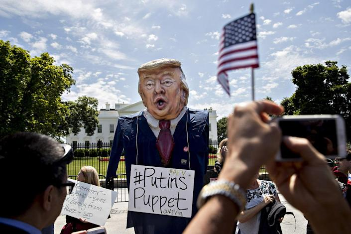 <p>A demonstrator wears an effigy in the likeness of President Trump during a protest at the White House on May 10. (Photo: Andrew Harrer/Bloomberg via Getty Images) </p>
