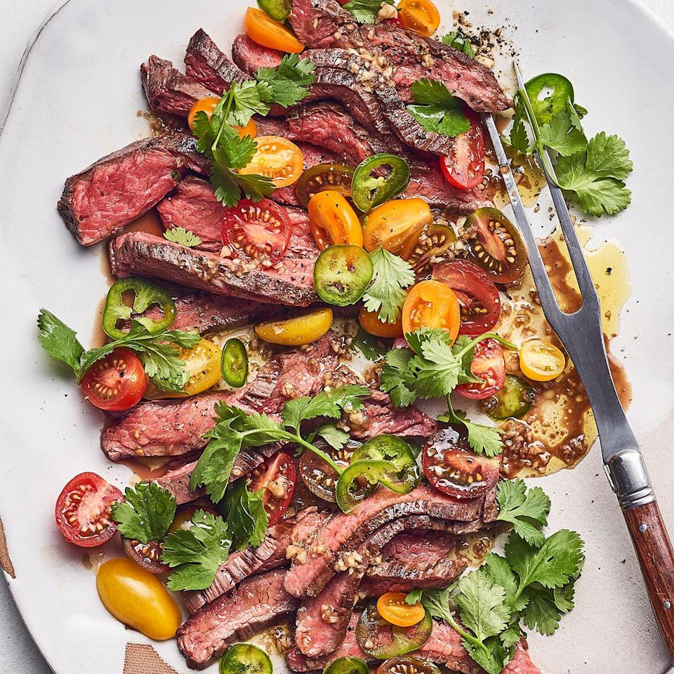 <p>Cutting the steak immediately after cooking breaks all the rules on meat cookery, but in this recipe we do it intentionally in order to capture the juices and incorporate them into the dressing. Serve this grilled flank steak recipe with crusty bread to soak up the deliciousness.</p>