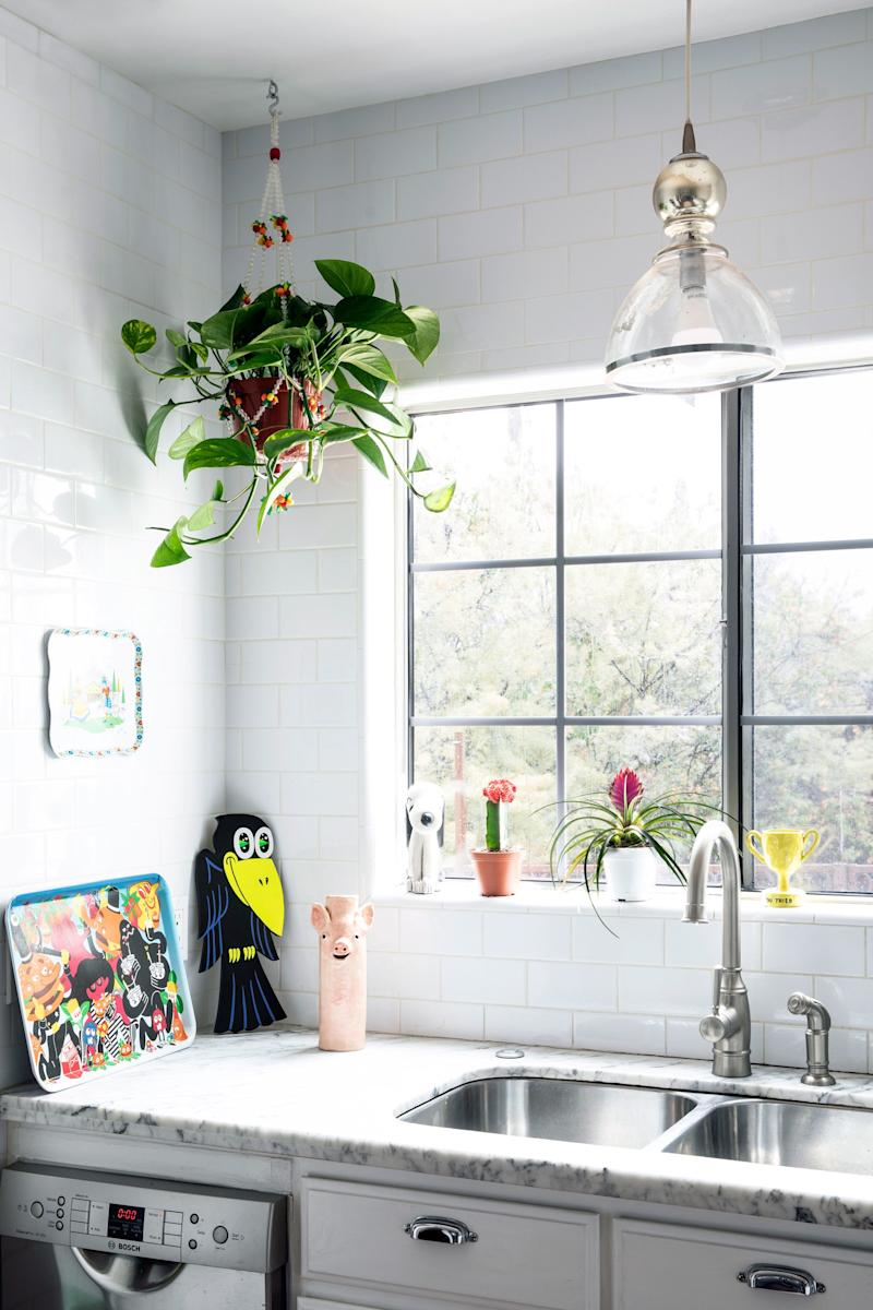 The kitchen is the couple's least favorite room because they have yet to figure out how to bring the same amount of kitsch and color to it as the rest of the house.