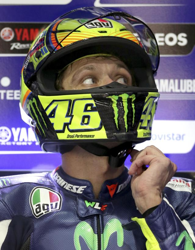 Yamaha MotoGP rider Valentino Rossi of Italy looks on in his box during a free practice session at the MotoGP World Championship at the Losail International circuit in Doha March 21, 2014. REUTERS/Fadi Al-Assaad (QATAR - Tags: SPORT MOTORSPORT)