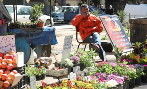Syrian residents of Damascus like florist Abdelqader Qasem are still struggling to rebuild their lives as the conflict that has devastated the country enters its 10th year