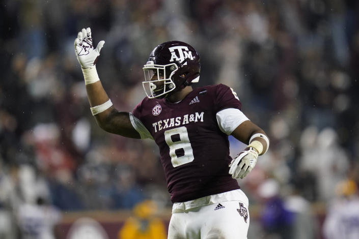 Texas A&M defensive lineman DeMarvin Leal gestures toward the crowd at Kyle Field before a third-down play by LSU during the first half of an NCAA college football game Saturday, Nov. 28, 2020, in College Station, Texas. (AP Photo/Sam Craft)