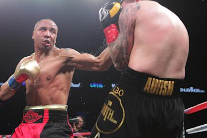 Andre Ward (L) lands a left hook on Paul Smith during their cruiserweight fight on June 20. (Getty)