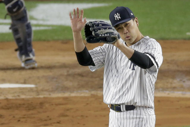 New York Yankees starting pitcher Masahiro Tanaka reacts as right fielder Aaron Judge makes a diving catch in right field against the Houston Astros during the fifth inning of Game 4 of baseball's American League Championship Series, Thursday, Oct. 17, 2019, in New York. (AP Photo/Seth Wenig)