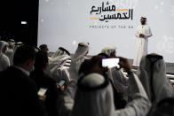 Emirati Economy Minister Abdulla bin Touq al-Marri speaks at an event announcing new economic programs in the United Arab Emirates in Dubai, United Arab Emirates, Sunday, Sept. 5, 2021. The United Arab Emirates announced Sunday a major plan to stimulate its economy and liberalize stringent residency laws for expatriates, as the country seeks to overhaul its finances and attract foreign residents and capital. (AP Photo/Jon Gambrell)