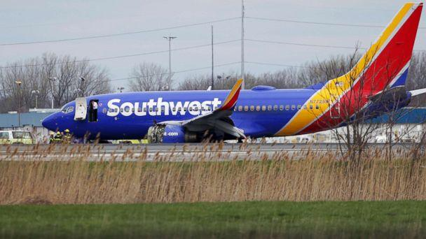 PHOTO: A Southwest Airlines plane sits on the runway at the Philadelphia International Airport after it made an emergency landing in Philadelphia, April 17, 2018. (David Maialetti /The Philadelphia Inquirer via AP)