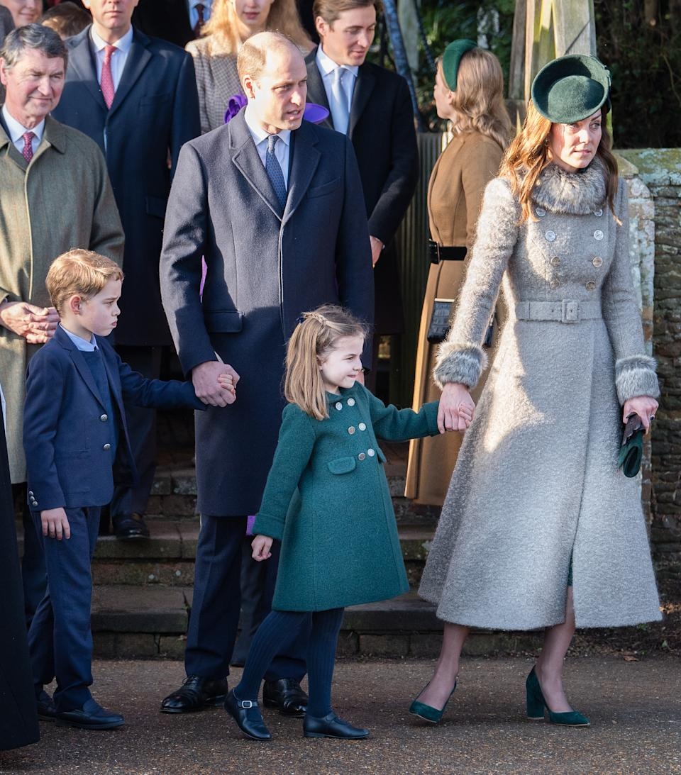 The Duke and Duchess of Cambridge lead their two eldest children, Prince George and Princess Charlotte, to meet royal fans outside the Church of St Mary Magdalene in 2019. Photo: Getty Images