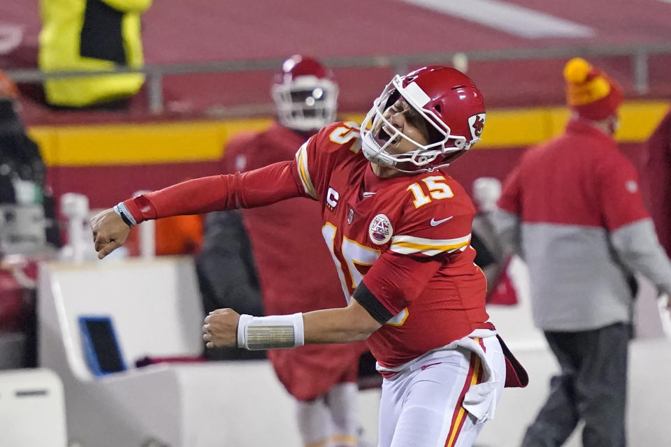 Kansas City Chiefs quarterback Patrick Mahomes celebrates after throwing a 5-yard touchdown pass to tight end Travis Kelce in the Chiefs' AFC championship game win. (AP Photo/Jeff Roberson)