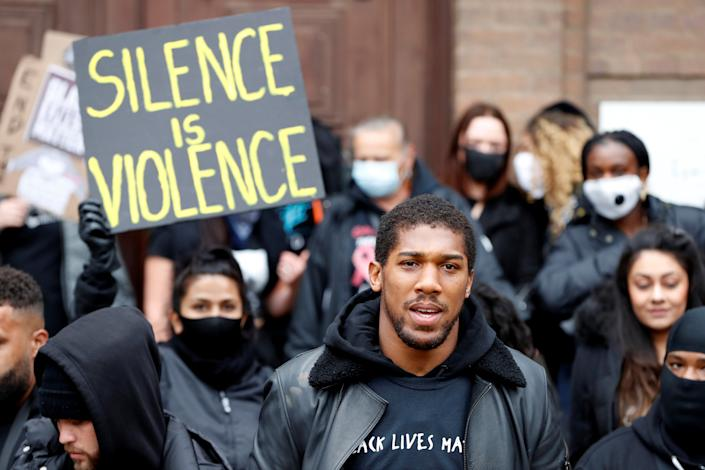 Boxer Anthony Joshua is seen with protestors during a Black Lives Matter protest in Watford, following the death of George Floyd who died in police custody in Minneapolis, Watford, Britain, June 6, 2020. REUTERS/Paul Childs