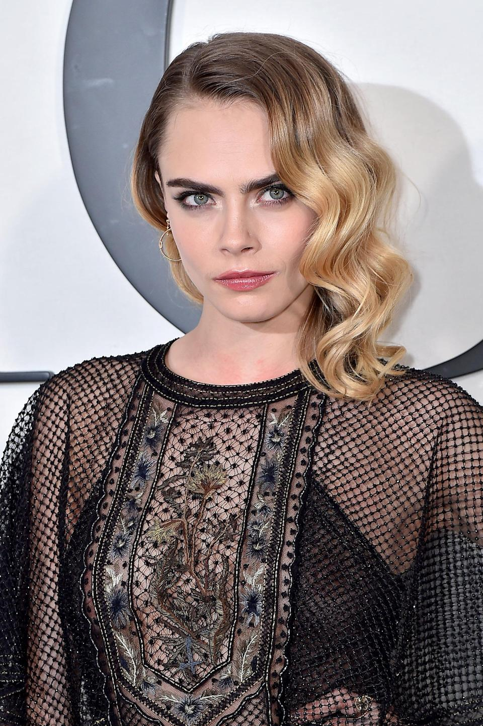 <p>In February, Delevingne took it back to basics with old Hollywood waves. She styled her hair in a side part tucked behind one ear, leaving the waves on her left side flow down. Simple and beautiful.</p>
