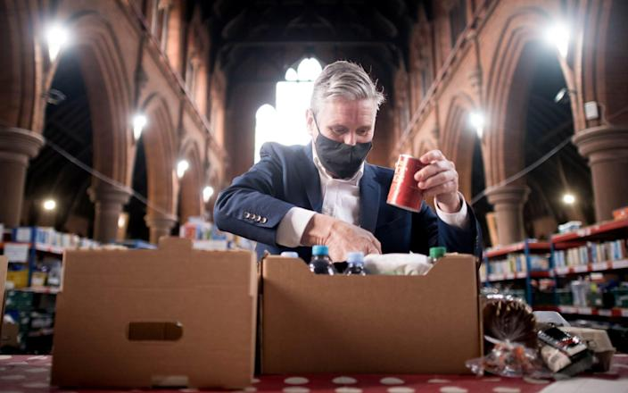 Saint Keir: Labour leader visits a food bank distribution centre in St Margaret The Queen church in Streatham - Reuters