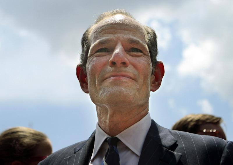 FILE- In this July 8, 2013, file photo, Eliot Spitzer appears in New York's Union Square to collect signatures for his surprise entry into the race for New York City Comptroller. The former New York governor's surprise entry into the city comptroller's race now means there are two sex scandal-comeback stories competing for the media's attention, and the constant mention of both in the same breath has once again put Anthony Weiner back under the lens. (AP Photo/Bethan McKernan, File)