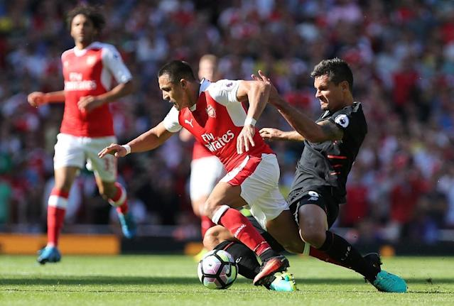 Arsenal's striker Alexis Sanchez (2ndR) is tackled by Liverpool's defender Dejan Lovren at the Emirates Stadium in London on August 14, 2016 (AFP Photo/Lee Mills)