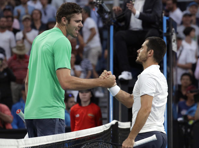 Italy's Thomas Fabbiano, right, is congratulated by United States' Reilly Opelka after winning their second round match at the Australian Open tennis championships in Melbourne, Australia, Wednesday, Jan. 16, 2019. (AP Photo/Aaron Favila)