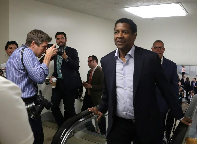 Actor Denzel Washington, pictured in 2018 after riding the Capitol Subway, is a among a long list of celebrity patrons that also includes Richard Gere, Chuck Norris, Jon Stewart and the rock star Bono (AFP/MARK WILSON)