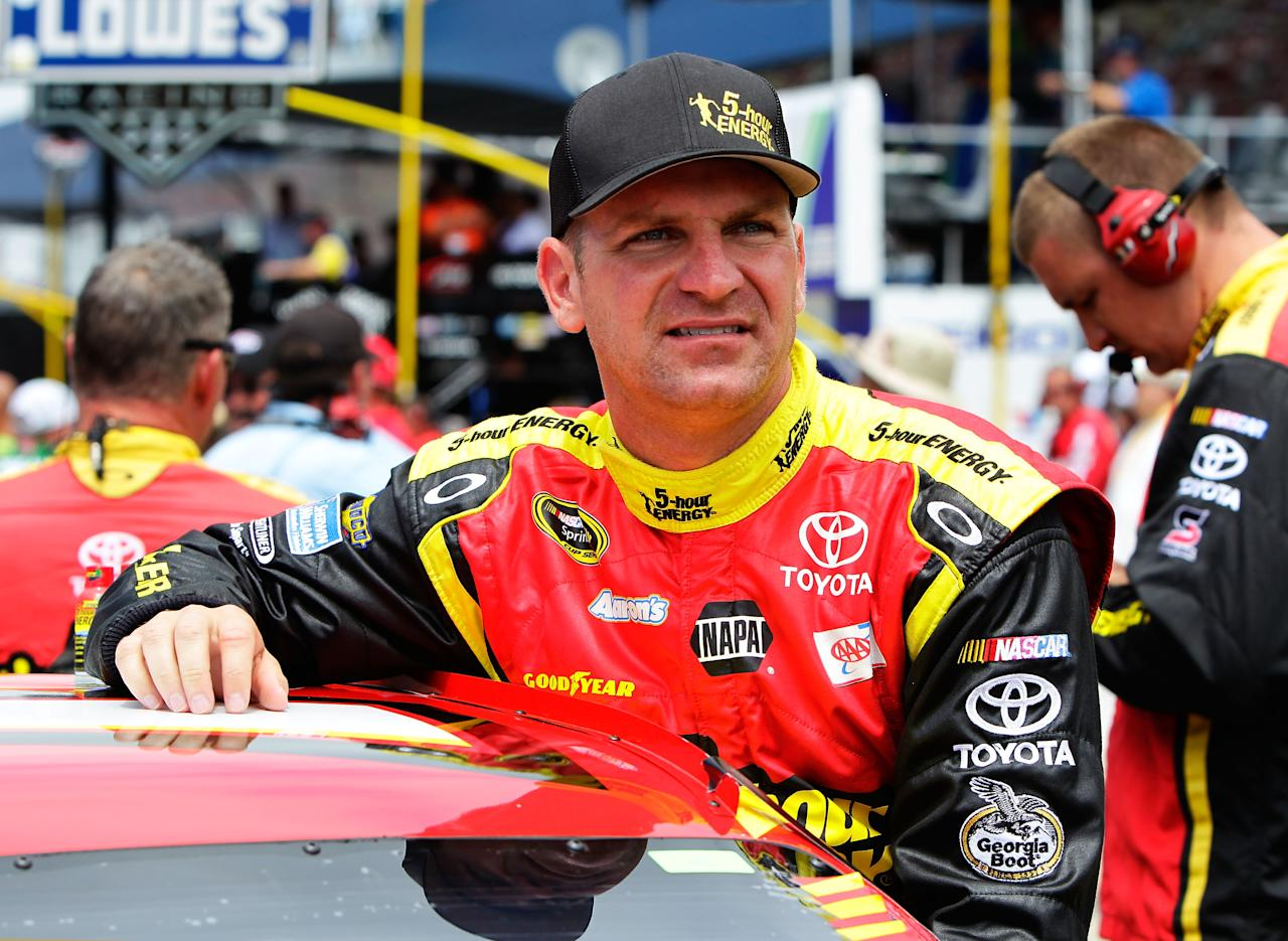 BROOKLYN, MI - JUNE 17:  Clint Bowyer, driver of the #15 5-hour Energy Toyota, stands on the grid during pre-race ceremonies for the NASCAR Sprint Cup Series Quicken Loans 400 at Michigan International Speedway on June 17, 2012 in Brooklyn, Michigan.  (Photo by Wesley Hitt/Getty Images for NASCAR)