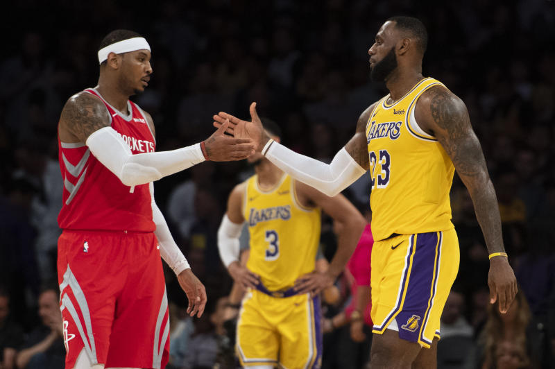 LOS ANGELES, CA - OCTOBER 20: Carmelo Anthony #7 of the Houston Rockets shakes hands with his good friend LeBron James #23 of the Los Angeles Lakers after the Lakers' home opener against the Houston Rockets at Staples Center in Los Angeles on Saturday, October 20, 2018. The Los Angeles Lakers defeated the Houston Rockets 124-115. (Photo by Kevin Sullivan/Digital First Media/Orange County Register via Getty Images)